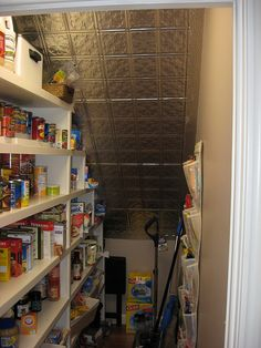 pantry under stairs - don't really like the tin ceiling but I like the shelving idea