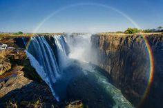 Zambia: full rainbow over Victoria Falls