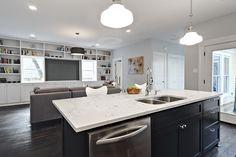 Avenue B: Lovely open kitchen - family room with schoolhouse pendants, glossy black kitchen island ...BM Moonshine