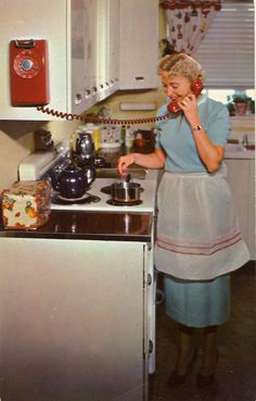Busy homemaker…a kitchen phone at her fingertips. No more frantic dashes, missed calls, burned meals. Brightens the kitchen, too. Both wall and regular phones come in this brilliant red as well as in yellow, brown, green, gray, ivory, blue, and beige.