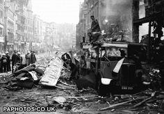 World War Two - UK & Commonwealth - The Home Front - The Blitz - London - 1940 1940 Rescue workers attend to a badly damaged bus in High Holborn, London, amid the damage caused by a Luftwaffe bombing raid during the blitz.