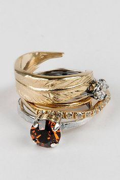 Vintage stacked rings; <3 the feather