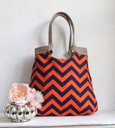 Orange/navy blue chevron bag with burlap trim via etsy. Love!