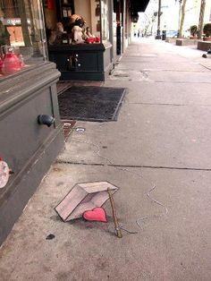 by David  zinn heart trap sidewalk art