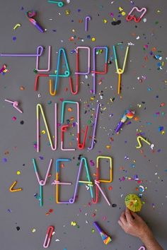 Put out a bucket of random things and challenge kids to make a Happy New Year sign.