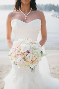 A romantic wedding bouquet in muted pastel tones.