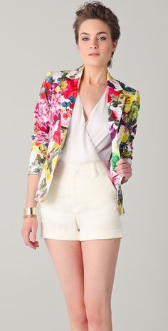 This floral Alice + Olivia jacket features a notched collar and a single-button closure. Flap hip pockets and double back vents. Padding at shoulders. 3-button cuffs at long sleeves. Lined.