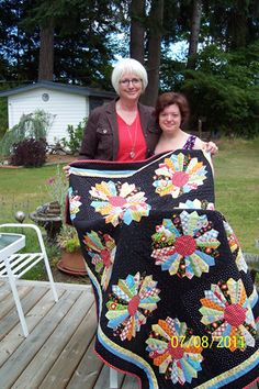 Dresden quilt, at Sweet P Quilting--love black background!