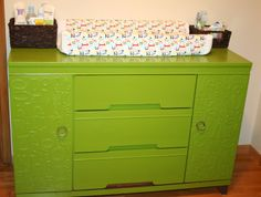 "This DIY dresser in ""Giggle Green"" adds a lot of character to this #nursery.  #green #dresser #chipboardletters"