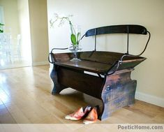 horse drawn carriage seat, repurposed into an entryway bench.