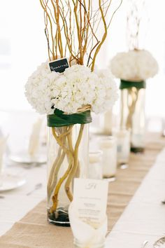 hydrangea and manzanita branch centerpiece // photo by Kina Wicks // http://ruffledblog.com/romantic-illinois-farm-wedding