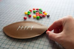 Fun Football craft for kids. Make easy football shaped candy pouches for them to eat during the game!