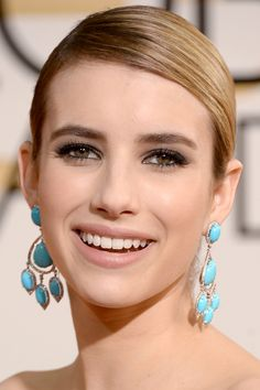 Emma Roberts sleekly groomed at the 2014 Golden Globes