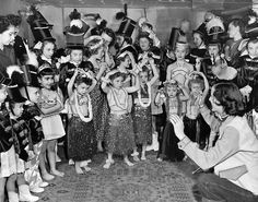 All winter long the Sparklettes practiced every Saturday in Robert Crisman's basement for The World-Herald's fourth annual Youth Parade in the spring of 1952. The group, which had children ages 2 to 12, had two floats in the parade. The Sparklettes were one of 60 groups to march in the parade. THE WORLD-HERALD