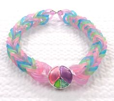 Rainbow loom bracelet with sliding peac charm