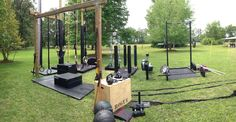 http://www.roguefitness.com/strength-equipment/squat-stands.php.                        Awesome outdoor setup