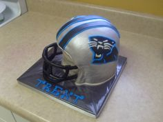 Carolina Panthers helmet By tarheelgirl on CakeCentral.com