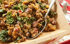 Sausage and Kale with Quinoa // A twist on common quinoa dishes, here the good-for-you grain is cooked in cider with smoked sausage, dried cranberries and hearty greens.