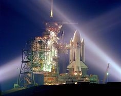 """Space Shuttle Columbia - Pre-launch, STS-1  The white painted External Fuel Tank was only flown on STS-1.  Columbia was the only Space Shuttle to have the black heat resistant tile on the """"chine"""" area of the forward wing."""
