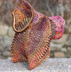 Wristbag.  Knitted recycled copper & plastic wire and copper pipe.