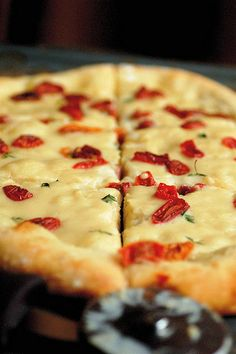 white pizza with roasted garlic coconut cream and sun-dried tomatoes - OMG. Best pizza crust recipe ever. And the sauce was delicious! Two heads of garlic in the recipe upset our stomachs the next day, but I would say it was worth it.