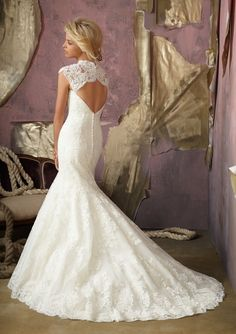 Mori Lee Style 1862 Elegant Alencon Lace with removable lace keyhole coverlet.