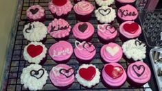 """Valentine's Day cupcakes that I made. White and milk chocolate designs are """"Almond Bark"""" from Walmart. Just design onto wax paper and let harden. Red is Ace of Cakes fondant."""