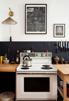 black tile backsplash and art prints.