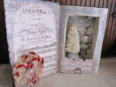 A shadowbox altered book by Glitterbug Studios. Cut one big niche, decorate, and you're done :)