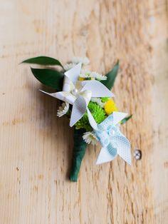 pinwheel boutonniere, photo by Rachel Havel http://ruffledblog.com/woodland-park-wedding #weddingideas #boutonnieres