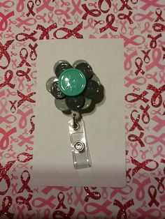 Medical badge reels made from chemotherapy vial tops on Etsy, $7.00