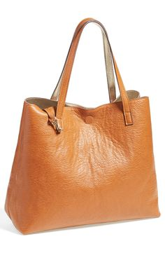 Fall staple! Metallic and Cognac reversible tote & wristlet.