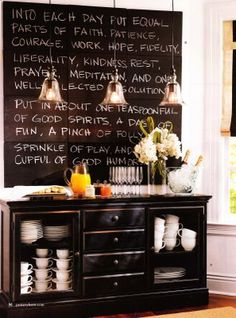 I love me some chalkboard paint! Don't like the black sideboard but I like the idea of it, and the drop pendants- might be too contemporary for my kitchen though