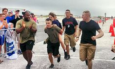A group of Marines helped a 11-year-old amputee finish a triathlon! The kid, a cancer survivor, lost a screw in his prosthetic leg and couldn't finish the race without it. That's when the group of Marines carried him all the way to the finish line!