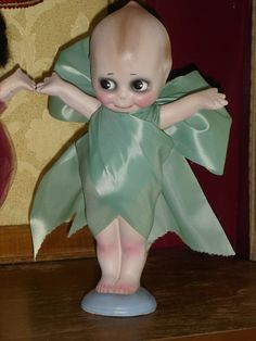 Chalkware Carnival Kewpie Doll Satin Bow via Etsy