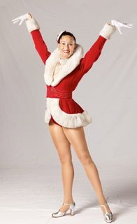 "The ""Rockettes Red Santa"" is one of the most signature Rockette looks and was designed by Pete Menefee and was introduced by the Rockettes in 1982."