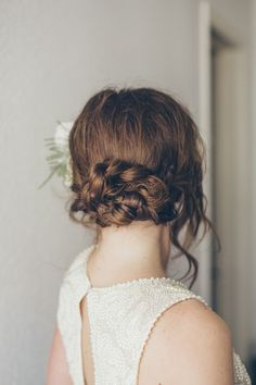 braided low bun – photo by nbarrett photography – http://ruffledblog.com/valentines-day-makeup #hair #wedding #braids