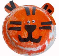 Our kids had a ton of fun making these yesterday in our preschool! The theme this month is Animals that Live in the Jungle: A Walk on the Wild Side.     Tiger paper plate craft