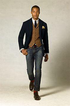 navy sport coat, brown tweed vest, white shirt, dark solid tie, web belt, blue jeans, red socks, dark brown lace ups
