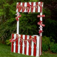 Booth with painted burlap banner in the front....and PINWHEELS!