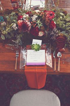 #burgundy tablescape - photo by Amy Wallen - http://ruffledblog.com/woodland-bohemian-wedding-ideas/