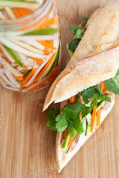 Vietnamese Pickled Vegetables |  1/4 lb. cucumber, julienned •  1/4 lb. daikon, peeled and julienned •  1/4 lb. carrots, peeled and julienned  •  1 tsp kosher or sea salt •  1 cup unseasoned rice vinegar •  2 tbsps + 2 tsps sugar  1 cup water