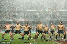 Amazing photo of the New Zealand team performing a Haka in a rainstorm after winning the Hong Kong Sevens Tournament