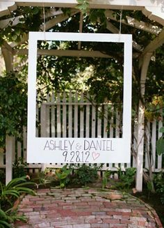Oversized Polaroid booth for wedding fun!  I'd probably put some hanging lanterns behind and decorate the hell out of the front :)