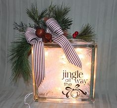 "We had a gift exchange at our weSTAMP Christmas party. This is the gift I made for the exchange. I added the ""Jingle All the Way"" Decor Elements to the glass block. On the inside, I put a small strand of white lights and some inexpensive white tinsel that I found at Target."