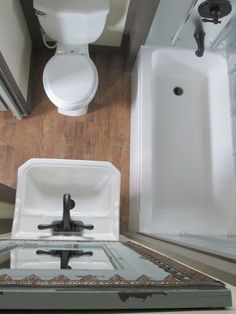 small, compact bathroom. VERY efficient layout. Like the stainless steel tub surround--really like this a little better than the wavy or corrugated sheets for this particular application
