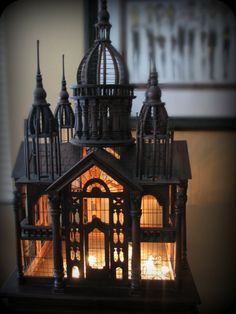 Victorian Architectural carved palace birdcage on matching stand. Georgeys Gal, via Etsy.