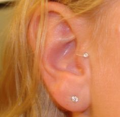 Simple diamond tragus ear piercing.