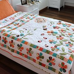 """A complete pattern and tutorial on the """"Secret Garden Trapunto Quilt"""" that's full of flowers, ladybugs, butterflies, snails, & songbirds etc"""