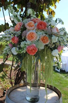 Love this peach and coral color combo! Peach and coral wedding flowers